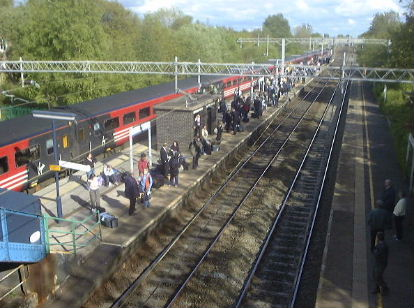 Passengers from a broken-down train waiting on Acton Bridge Station